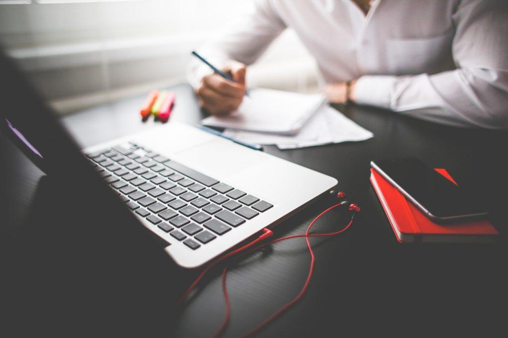 entrepreneur-working-on-his-macbook-adjusted